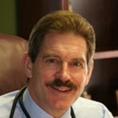 John E West, MD profile photo